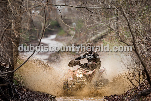 Craig Englert of Birdseye sped through a creek on the 8-mile course of a Midwest Cross Country Racing ATV competition in Gosport on April 1. Englert placed 12th in his class.