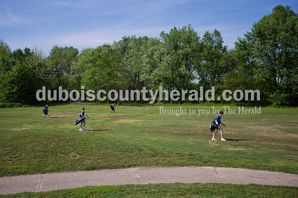 Luke Trout of Holland, 13, Gabe Boeglin of Holland, 12, Corbin Begle of Jasper, 13, and Reid Harmon of Jasper, 13, made their way across the fairway during the first day of the Dubois County Junior Golf program on Tuesday at Ruxer Golf Course in Jasper.    Alisha Jucevic/The Herald