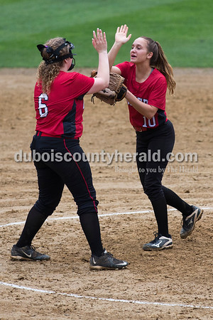 Southridge's Morgan Stapleton, left, and Boo Polley high-fived between innings during Friday's softball game in Lincoln City. Heritage Hills defeated Southridge 10-5. Sarah Ann Jump/The Herald