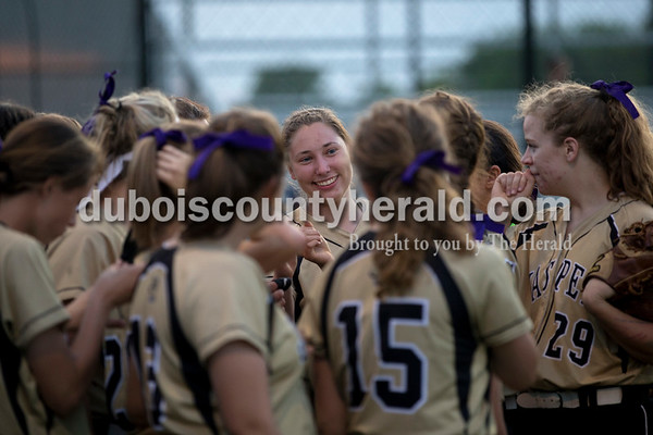 Jasper's Rachel Gress, center, huddled up with her team before the bottom of the seventh inning during Tuesday night's game against South Spencer in Jasper. The Wildcats lost 5-3.   Alisha Jucevic/The Herald