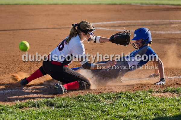 Northeast Dubois' Brooklyn Dodd slid safely back into third base as the ball soared past Southridge's Amanda Brewer during Monday's softball game in Huntingburg. Northeast Dubois defeated Southridge 14-9. Sarah Ann Jump/The Herald