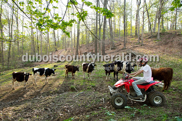 Craig Englert started up his ATV after taking a break from riding in his cow pasture at his Birdseye home on April 18.