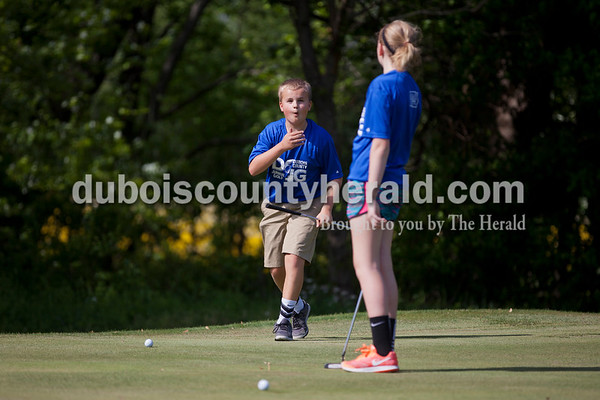 Noah Hanneman, 13, left, and Meredith Heim, 14, both of Jasper, reacted after Meredith missed a putt during the first day of the Dubois County Junior Golf program on Tuesday at Ruxer Golf Course in Jasper.   Alisha Jucevic/The Herald