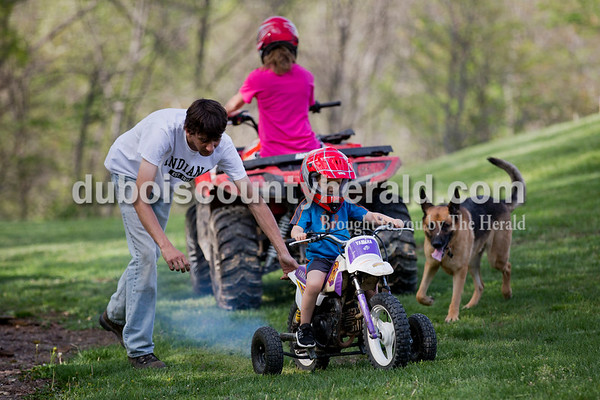 Craig Englert helped his nephew Wren Englert, 3, get started on his dirt bike as his sister Katelyn Englert, 16, rode an ATV at their Birdseye home on April 18.