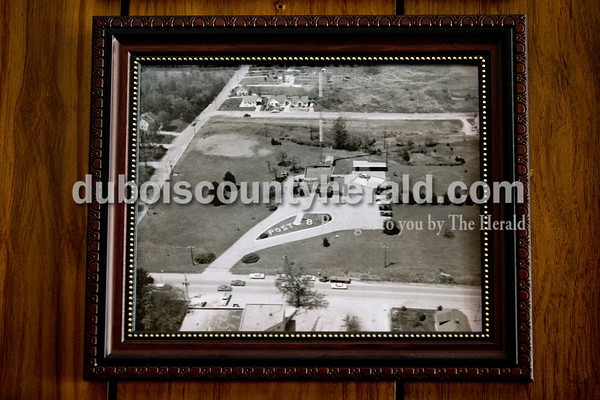 "Alisha Jucevic/The Herald      An aerial view of Indiana State Police Post from the 1960s shows the white pine as a young tree. It can be spotted just below and to the right of the ""Post 8"" sign on the grass."