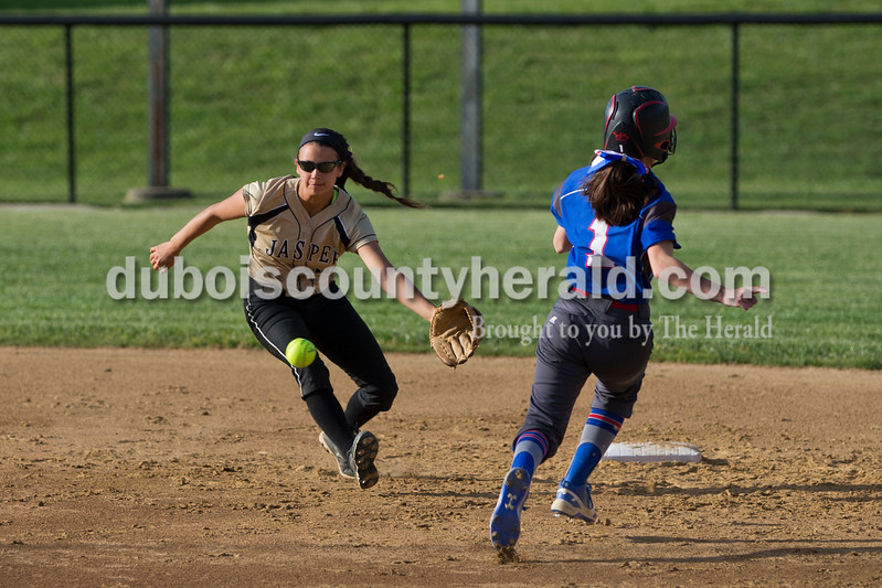 Jasper's Alexa Stenftenagel ran to field the ball as South Spencer's Mallory Toler ran safe into second base during Tuesday night's game in Jasper. The Wildcats lost 5-3. <br /> <br /> Alisha Jucevic/The Herald