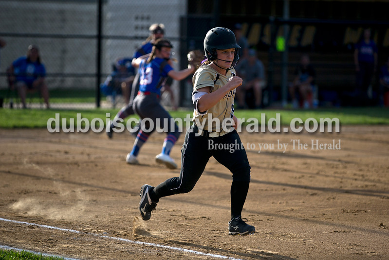 Jasper's Grace Werner made it safe into first during Tuesday night's game against South Spencer in Jasper. The Wildcats lost 5-3. <br /> <br /> Alisha Jucevic/The Herald