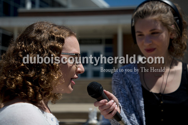 Sarah Ann Jump/The Herald Jasper High School senior Brea Mullen, left, was interviewed by her classmate senior Amanda Ackerman on live radio during a bake sale at the school on Monday afternoon.