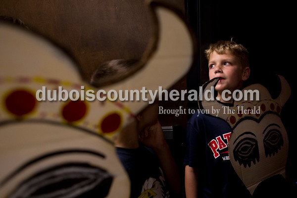 "Sarah Ann Jump/The Herald Lincoln Trail Elementary School fourth-grader Jacob Hockenberry waited with his cardboard wildebeest head before entering the auditorium during Tuesday's ""Lion King Jr."" play rehearsal at Heritage Hills High School in Lincoln City."