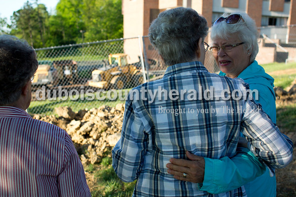 Tegan Johnston / The Herald Dana Hoffman of Jasper, right, greeted Sister Joella Kidwell, the federation president, before the demolition of Madonna Hall at Sisters of St. Benedict in Ferdinand on Tuesday morning. The large residence hall was a home to many sisters at the Academy since it was built in 1968.