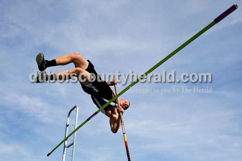 Tegan Johnston / The Herald<br /> Southridge's Brad Springer flung himself over the bar while competing in the pole vault during the Northeast Dubois invitational on Tuesday in Dubois.