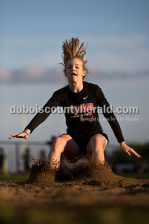 "Southridge's Anna Altstadt landed a 14' 7"" long jump during Thursday's Southridge Invitational in Huntingburg. Altstadt placed third. Sarah Ann Jump/The Herald"