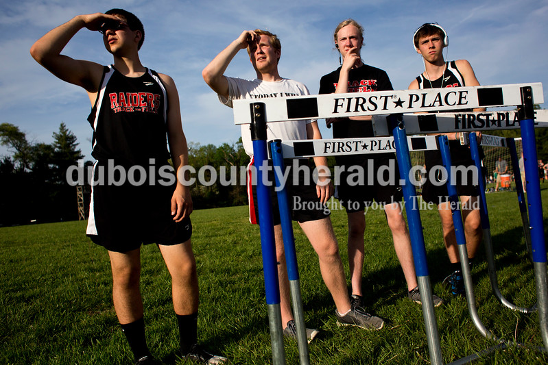 Tegan Johnston / The Herald<br /> Southridge's Nathan Bromm, Kru Allen, Logan Hunter and Corbin Neher cheered on their teammates as they competed during the Northeast Dubois invitational on Tuesday in Dubois.