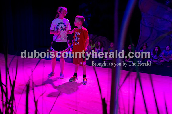 "Sarah Ann Jump/The Herald David Turnham Education Center sixth-grader Emma Klueh, left, and fifth-grader Elliot Fischer portrayed Mufasa and young Simba during Tuesday's ""Lion King Jr."" play rehearsal at Heritage Hills High School in Lincoln City."