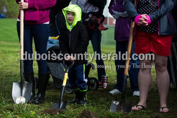 Tegan Johnston / The Herald Xavier Ayala of Huntingburg, 4, dug his shovel into the ground during Habitat for Humanity of Dubois County's ground breaking ceremony for the next home building project on Saturday in Huntingburg. Amy Ayala of Huntingburg and her two children Xavier, 4, and Lilliana, 1, were the selected recipients for the new home.