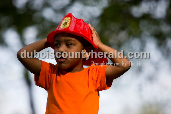 Tegan Johnston / The Herald Jaxyn Knies of Ireland, 4, held onto his firefighter hat as he explored during the Kids' Fest on Wednesday at Jaycee Park in Jasper. The Dubois County Department of Child Services partnered with other local child advocacy agencies to raise awareness for the prevention of child abuse. Families enjoyed food, games and other activities while learning about child abuse prevention services.
