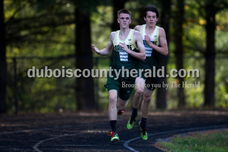 Tegan Johnston / The Herald<br /> Forest Park's Ben Becher paced off teammate Evan Hamilton, left, while competing in the 1600-meter run during the Northeast Dubois invitational on Tuesday in Dubois.