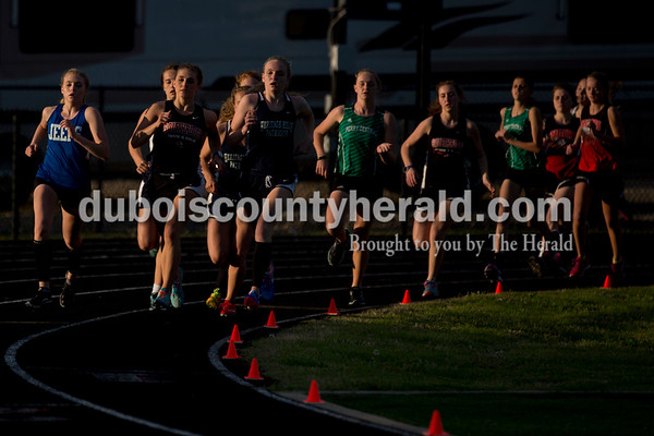 Runners raced in the 1600-meter run during Thursday's Southridge Invitational in Huntingburg. Sarah Ann Jump/The Herald