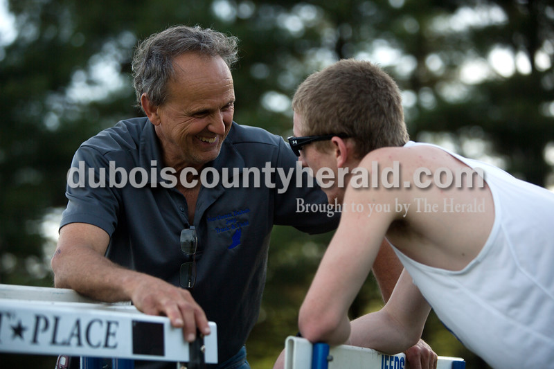 Tegan Johnston / The Herald<br /> Northeast Dubois' coach Vic Betz encouraged Quinn Dorsam before his event during the Northeast Dubois invitational on Tuesday in Dubois.