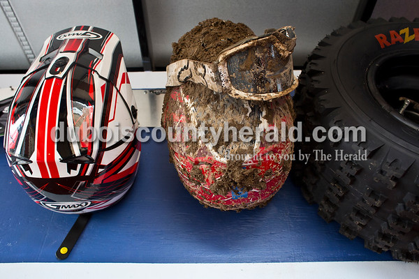 Jade Hoffman of Celestine's helmet hung next to Craig Englert of Birdseye's muddy helmet and googles after the ATV race in Gosport on April 1.