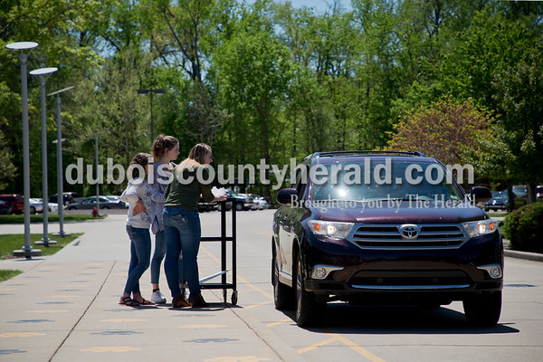 Sarah Ann Jump/The Herald Jasper High School seniors Brea Mullen, left, Amanda Ackerman and Hannah Rydberg sold bake goods to a customer during a bake sale at the school on Monday afternoon.