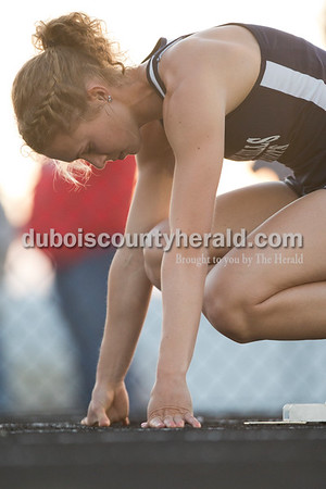 Heritage Hills' Kerragan Mulzer took her place on the starting block before the 200-meter dash during Thursday's Southridge Invitational in Huntingburg. Sarah Ann Jump/The Herald