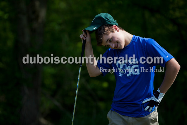 Brant Tretter of Ferdinand, 13, reacted after teeing off during the first day of the Dubois County Junior Golf program on Tuesday at Ruxer Golf Course in Jasper.  Alisha Jucevic/The Herald