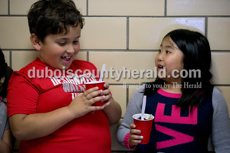 Fifth Street School first-graders Maddox Moya and Kimmy Lam chatted in the hallway after making Delicious Dirt pudding during their Fun Friday period Friday afternoon in Jasper.  <br /> <br /> Alisha Jucevic/The Herald