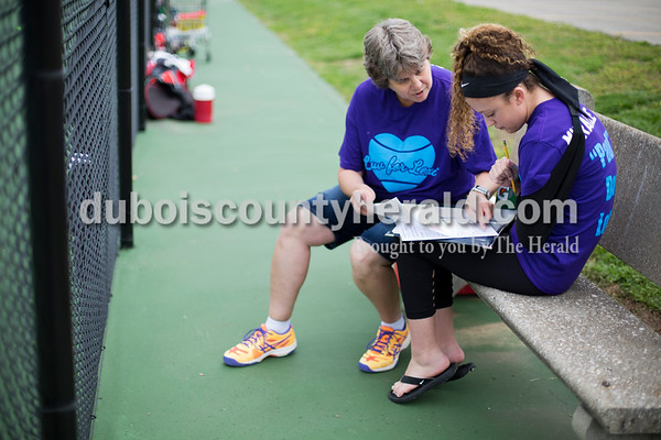 Sarah Ann Jump/The Herald Tennis head coach Rhonda Diekhoff showed Southridge High School sophomore Lexi Mattingly of Holland, 16, how to complete the match line up, one of Lexi's responsibilities as team manager, before a tennis match at the school in Huntingburg on Monday.