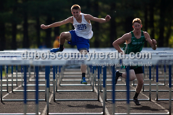 Tegan Johnston / The Herald Northeast Dubois' Alan Kerstiens competed in the 100-meter hurdles during the Northeast Dubois invitational on Tuesday in Dubois.
