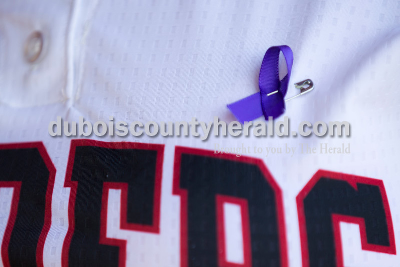 Southridge players wore purple ribbons in memory of Lexi Mattingly during Monday's softball game in Huntingburg. Northeast Dubois defeated Southridge 14-9. Sarah Ann Jump/The Herald