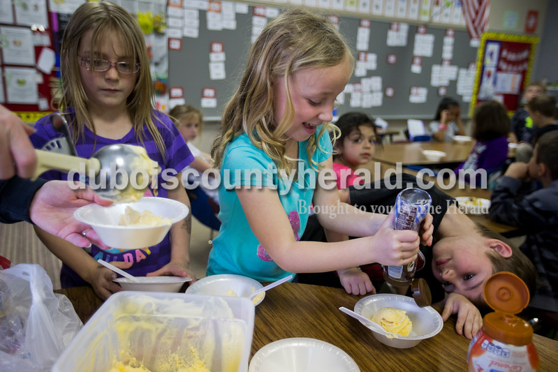Fifth Street School kindergartners Maddie Woosley, left, Finley Ward and Kayden Strohmeyer made ice cream sundaes during one classroom's sundae party for Fun Friday on Friday afternoon in Jasper. <br /> <br /> Alisha Jucevic/The Herald