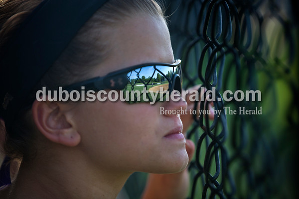 Jasper's Lexie Jerger watched Tuesday night's game against South Spencer in Jasper. The Wildcats lost 5-3.   Alisha Jucevic/The Herald