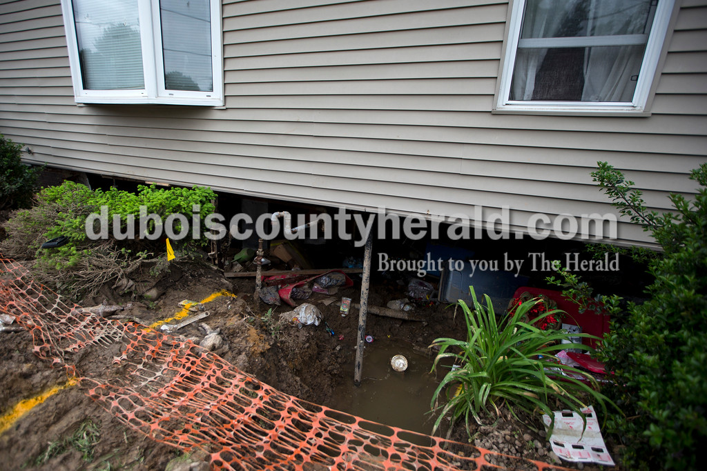 A long section of the foundation and basement wall caved in under Rene Katterhenry's home on East 1st Avenue and South Washington Street in Huntingburg during last weekend's storm. <br /> Alisha Jucevic/The Herald