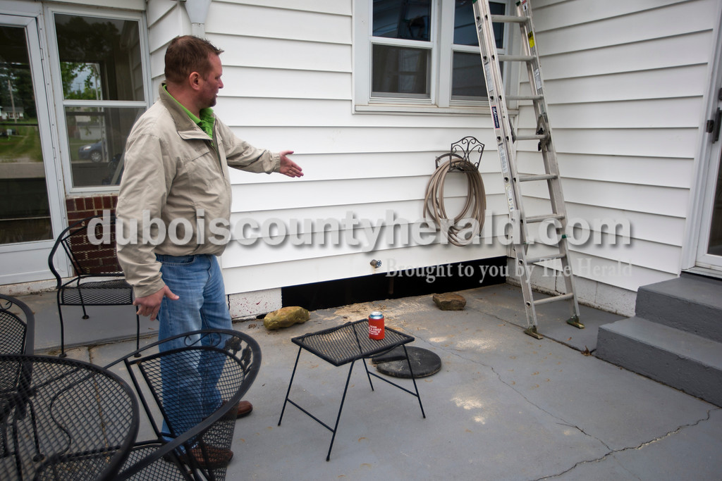 Damian Hartke and his family's basement flooded during the weekend storm. The pressure of the flooding caused two sections of the basement walls and foundation to cave in. <br /> <br /> Alisha Jucevic/The Herald