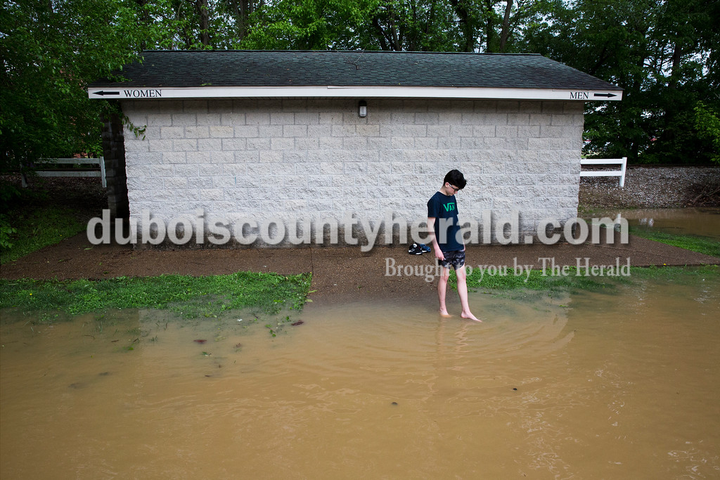 Sarah Ann Jump/The Herald<br /> Rocco Fanello of Jasper, 12, dipped his toes in the water at Dave Buehler Plaza in Jasper on Sunday afternoon. He waited while his brother kayaked and his parents walked further upstream.
