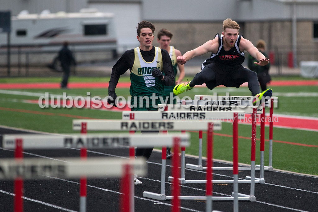 Forest Park's Blake Mohr and Southridge's Nathanial Pendley competed in the 300-meter hurdles during Monday night's track meet at Southridge High School in Huntingburg. <br /> Alisha Jucevic/The Herald