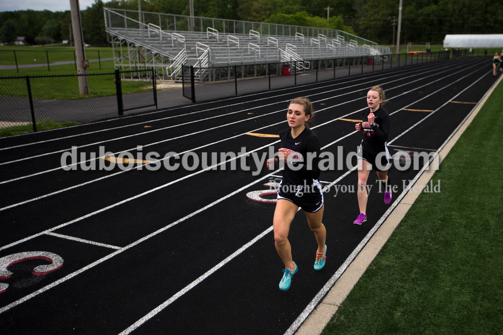Southridge's Lauren Meyer, left, Brooklyn Tretter competed in the 1600-meter run and during Monday night's track meet at Southridge High School in Huntingburg. <br /> Alisha Jucevic/The Herald