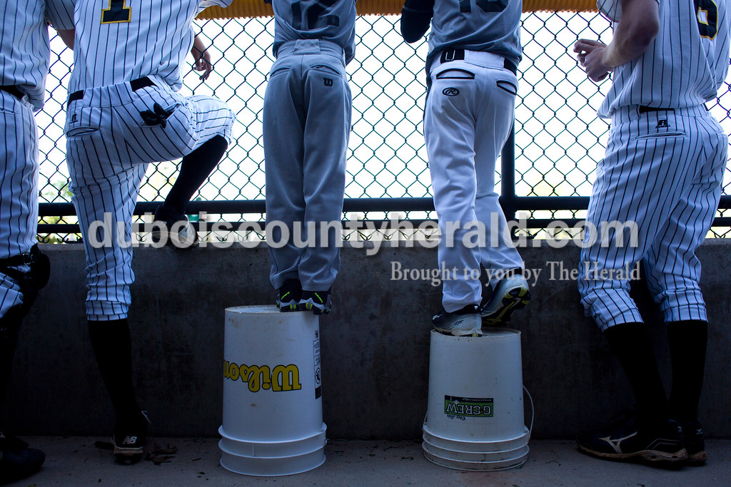 Tegan Johnston / The Herald<br /> Jasper's ball boys Nicolas Aguilera and Sutton Brosmer, both 8, stood on buckets while watching Jasper bat during Tuesday night's game against Forest Park at Ruxer Field in Jasper. Jasper defeated Forest Park 14-1.