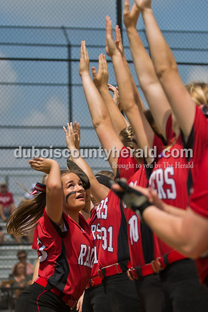 Southridge's Macie Marley jumped to high-five her teammates during player introductions before Saturday's 3A softball sectional championship game in Jasper. Vincennes Lincoln defeated Southridge 10-2. Sarah Ann Jump/The Herald