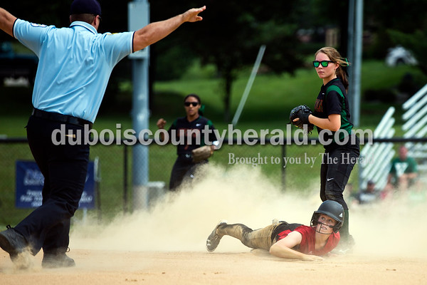 Southridge's Misty Merter looked to the official to see him declare her safe after sliding into second base during Saturday's 3A softball sectional championship game in Jasper. Vincennes Lincoln defeated Southridge 10-2. Sarah Ann Jump/The Herald