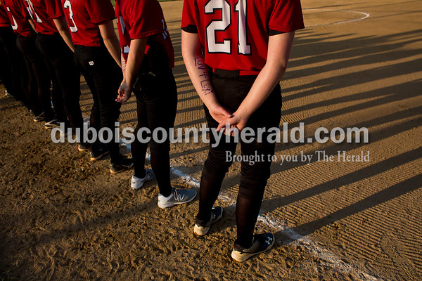 """Southridge's Misty Merter and her teammates wrote """"Luv 4 Lexi"""" on their arms in purple in memory of Lexi Mattingly during Thursday's 3A softball sectional semifinal game in Jasper. Southridge defeated Washington 8-5. Sarah Ann Jump/The Herald"""