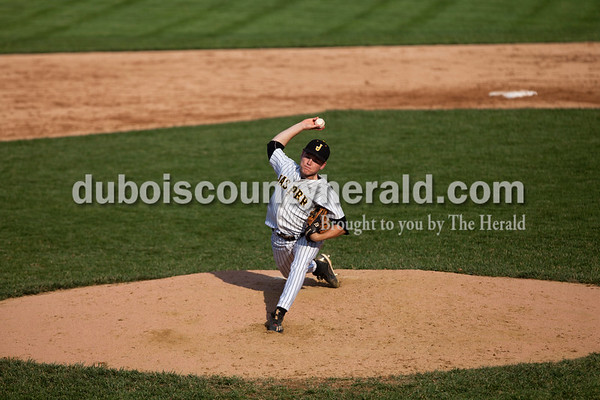 Tegan Johnston/The Herald Jasper's Reece Kleinhelter delivered a pitch during Thursday's Class 3A sectional championship at Ruxer Field in Jasper. Jasper defeated Vincennes Lincoln 8-4.