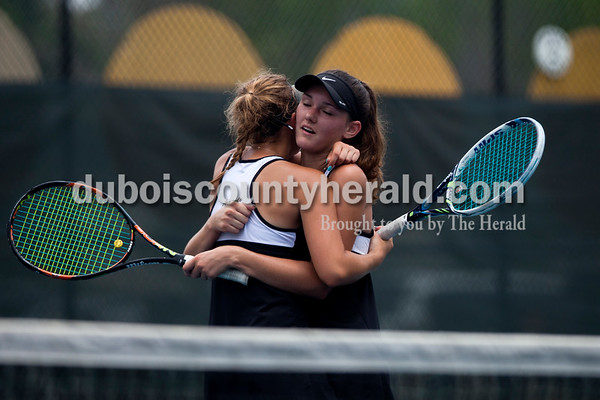 Tegan Johnston/The Herald Jasper's Caroline Theil, left, hugged her partner Olivia Yarbrough after winning the No. 1 doubles match of Saturday's semistate tennis match in Jasper. The Wildcats dumped Evansville Memorial 4-1 for semistate title - it's the 3rd straight state finals berth for the Wildcats.