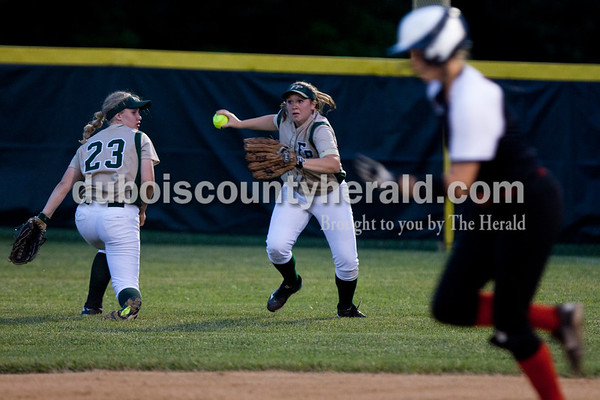 Tegan Johnston/The Herald Forest Park's Lauren Roos ran to pass the ball to second base during Tuesday's IHSAA Class 2A sectional game in Bretzville. Forest Park lost to North Posey in the seventh inning 1-0.