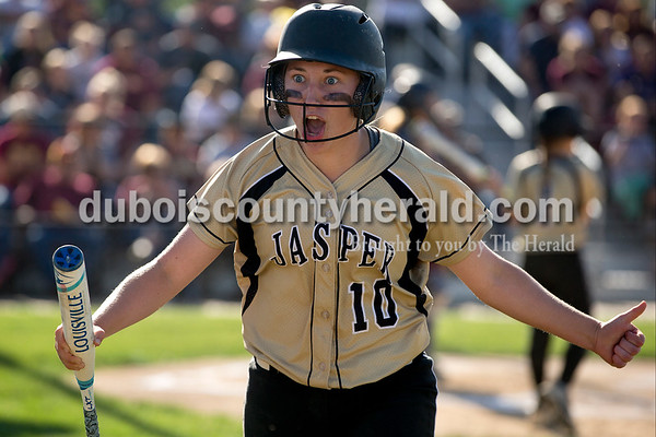 Jasper's Rachel Gress celebrated after scoring the Wildcat's first run during Monday's Class 3A softball sectional opener against Pike Central in Jasper. The Wildcats defeated Pike Central 3-0. Dave Weatherwax/The Herald