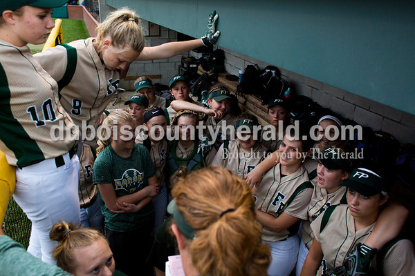 Tegan Johnston/The Herald Forest Park's coach Kelly Schroering talked to her team before Tuesday's IHSAA Class 2A sectional game in Bretzville. Forest Park lost to North Posey in the seventh inning 1-0.