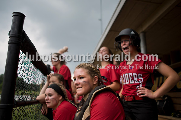 Southridge's Kendyl McKeough bit her lip as she watched the action from the dugout with her teammates during Saturday's 3A softball sectional championship game in Jasper. Vincennes Lincoln defeated Southridge 10-2. Sarah Ann Jump/The Herald