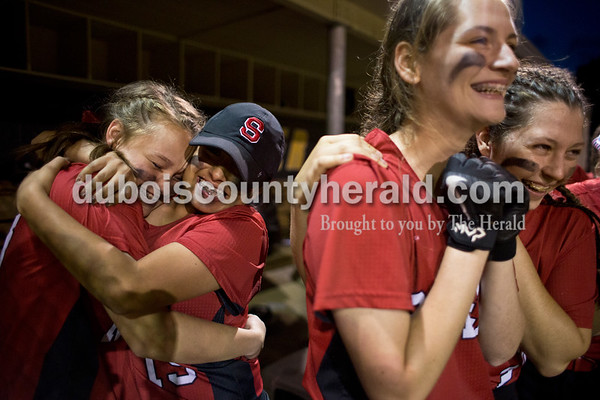 Southridge's Kolby Jones, left, and Gina Flores, hugged as Shelby Worden and Rachel Trent anxiously watched the final inning together during Thursday's 3A softball sectional semifinal game in Jasper. Southridge defeated Washington 8-5. Sarah Ann Jump/The Herald