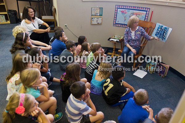 Sarah Ann Jump/The Herald Fifth Street School principal Leah Jessee sat in as librarian Sabrina Peters read to students at the school in Jasper on Wednesday morning.